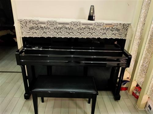 珠江鋼琴9成新,聯系電話13909008141
