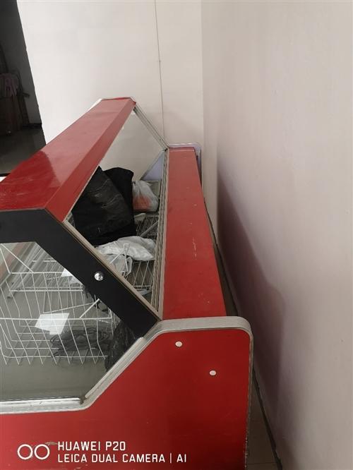 弧型冷藏保鲜展示柜2m长,买成五千多,仅用半年多,现在闲置,欲购从速自提。 正阳新城檀香山车库旁门...